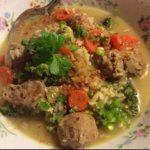 Soup w/ Rice, Veggies, and Meatballs. Spicy and served hot with soy sauce & lemon. By Siti Z Saekan