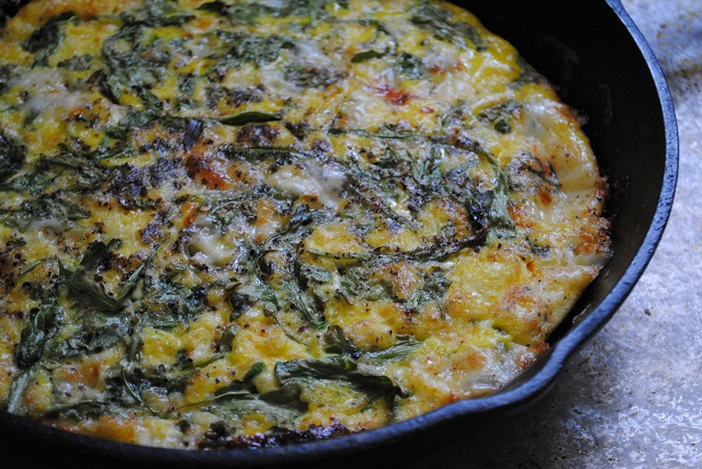 arugula frittata cooked in cast iron pan