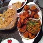 Bangladeshi iftar with biriyani, fried potatoes and piaji