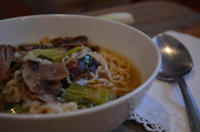 ramen in bowl with spoon on side