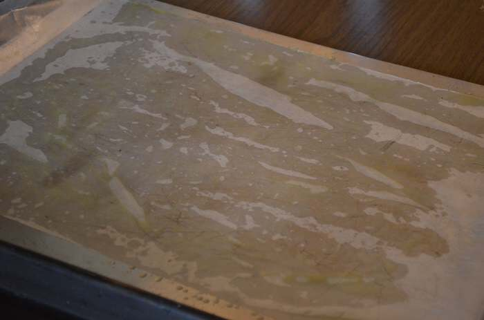 spread parchment paper on top