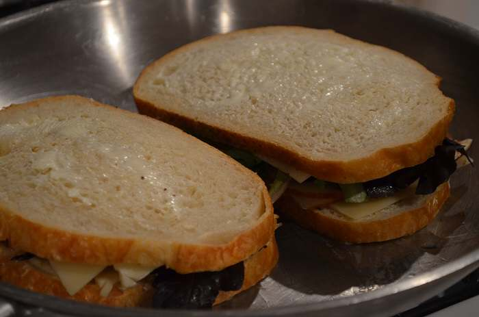 two sandwiches in pan