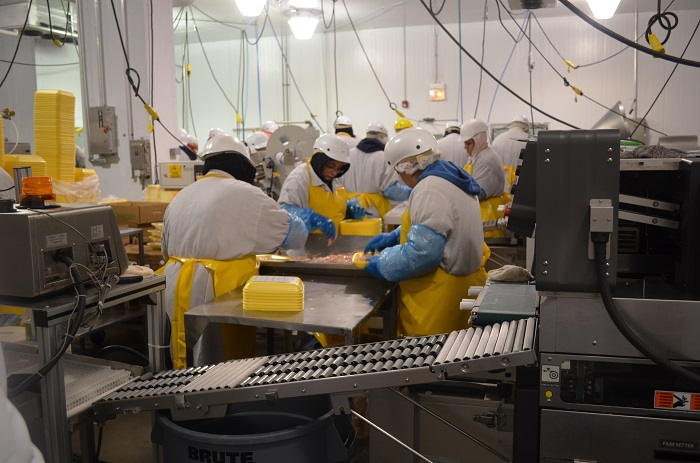 workers on production line A Fascinating Glimpse at the Crescent Foods Plant Tour
